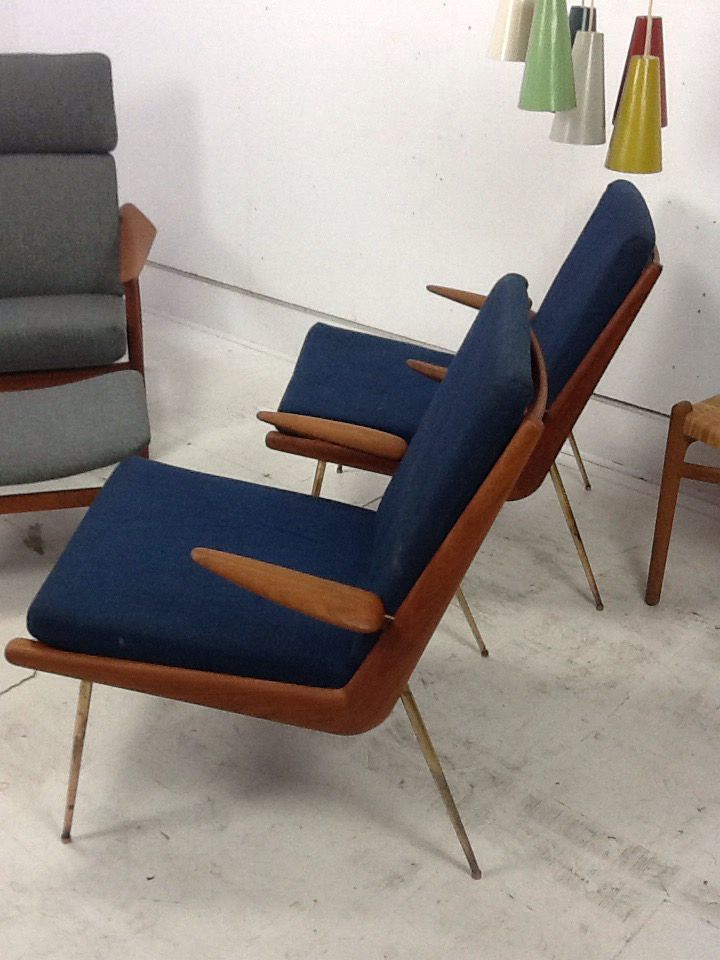 A lovely and rare pair of peter hvidt & orla mølgaard-nielsen designed BOOMERANG chairs. Stunning patina and lovely condition on frame and cushions. Fitted with new expersprings in both chairs. Buy here  http://bit.ly/1N2t3MK
