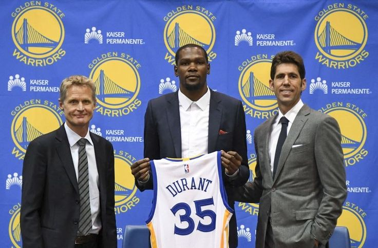 Kevin Durant || Image Source: http://cdn.fansided.com/wp-content/blogs.dir/307/files/2016/08/9372980-kevin-durant-steve-kerr-bob-myers-nba-golden-state-warriors-press-conference-850x560.jpgc3jvn6tmis1hbhoy14qrj1b.jpg?height=225&width=400