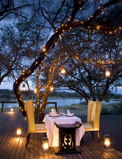 String lights on patio. I would do this as a single woman, candle light dinners are just as relaxing and beautiful alone.