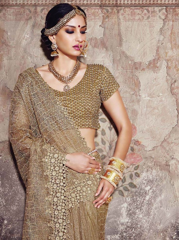 Golden stunning saree with unique works and designs for the diva in you. #Drezzling #Diva #GoldenSaree