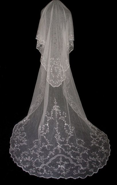 d design is stunning! Swiss dots or Point De'spirit throughout the veil. This veil can be worn with a blusher veil, a comb at the back of the head, or attached to a head piece, this will make the veil its full length.  Shade is Ivory, this can be changed to white if desired.