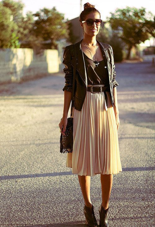 Go for a black leather moto jacket and a beige pleated midi skirt to create a chic, glamorous look. Finish off your look with dark brown leather wedge ankle boots.   Shop this look on Lookastic: https://lookastic.com/women/looks/biker-jacket-tank-midi-skirt/18165   — Dark Brown Sunglasses  — Black Leather Biker Jacket  — Black Tank  — Dark Brown Leather Belt  — Dark Brown Fringe Crossbody Bag  — Beige Pleated Midi Skirt  — Dark Brown Leather Wedge Ankle Boots