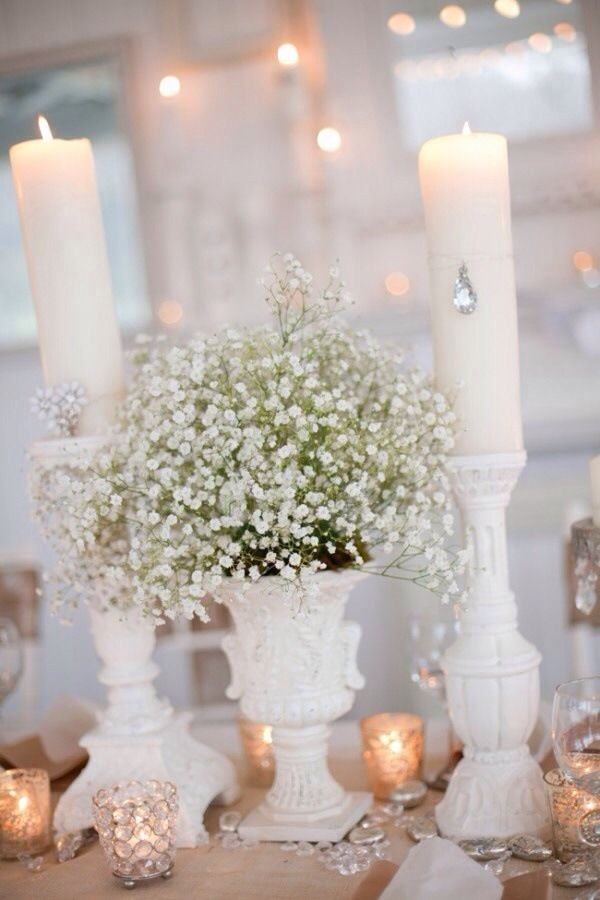 Beautiful table! Use baby's breath to go with any white theme and Mirage LED flickering flame candles as your safe light source. Candle Impressions Frosted Glass Holders in white would also look beautiful with this! #candlescapes #candledecor #candlecenterpieces