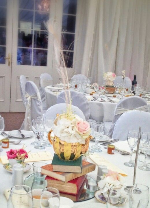 Teapot centrepieces at Clonabreany House wedding venue.