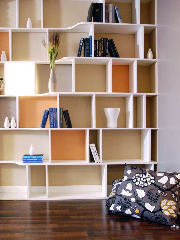 Give a shelving unit a colorful update with a fresh coat of paint. Choose two or three colors that complement each other and the room's furnishings. Paint shades of each color on the backs of the alcove shelves, while leaving the rest of the shelves white or neutral. Accent the structure with simple books and small accessories. Design by John Gidding