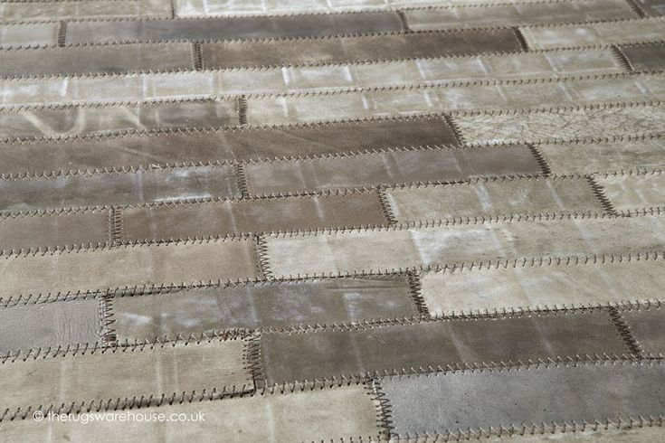 Moura Rug (texture close up), a handmade 100% leather rug in shades of soft brown, beige & grey http://www.therugswarehouse.co.uk/clearance/moura-rug.html #rugs #interiors