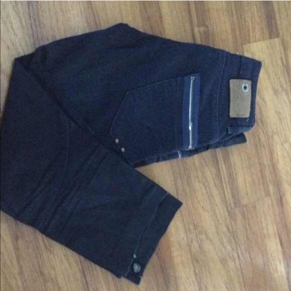 Cropped G Star Raw Jeans. EXCELLENT condition. Cropped G Star Raw Jeans. EXCELLENT condition. Smoke free and pet free home. No signs of wear. Dark blue wash jean. Button on the bottom of leg. Like new condition. No fading or signs of wear. G Star Raw Pants