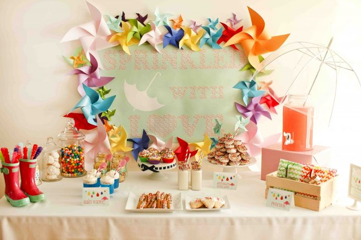 I absolutely adore the rainboots at candy containers!  Great for a shower theme! Precious! {Whimsical Feature} Rainbow Sprinkle Baby Shower | Whimsically Detailed