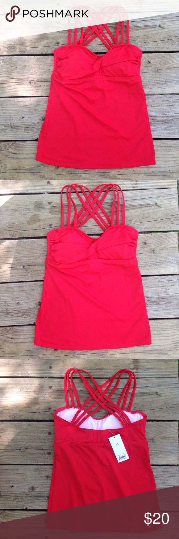 NWT Lime Ricki red tankini top Brand new beautiful, modest tankini top. Bright red. The straps cris cross in the back. Would be fun paired with a floral or patterned bottom. Would fit xxs as well. It's little. Lime Ricki Swim Bikinis