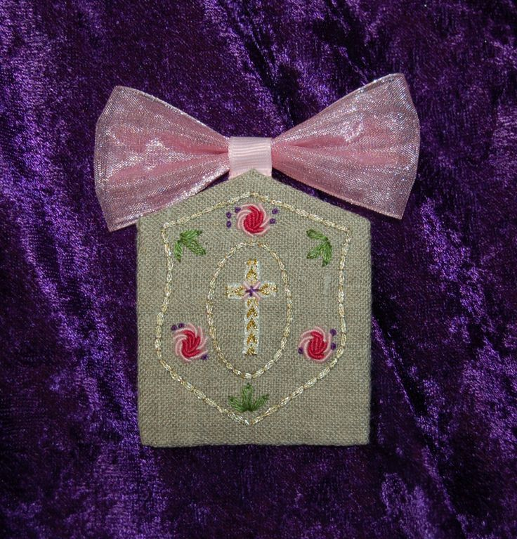 "Escapulario; Pin back brooch; 2.25"" x 2.50""; natural linen with hand embroidered shield, cross, and bullion roses; 3.26.27"