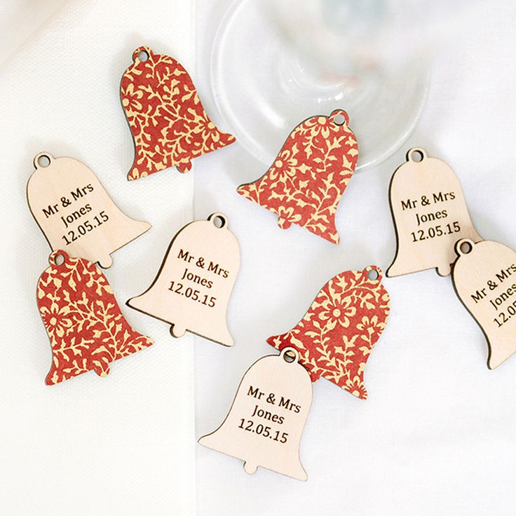 Tiny little wooden wedding bells favours finished  in our Masala vintage hand silk screened paper- just cute.