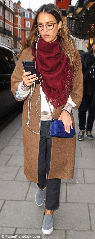 New look:The 35-year-old actress and entrepreneur wore a pair of dark trousers, a brown c...