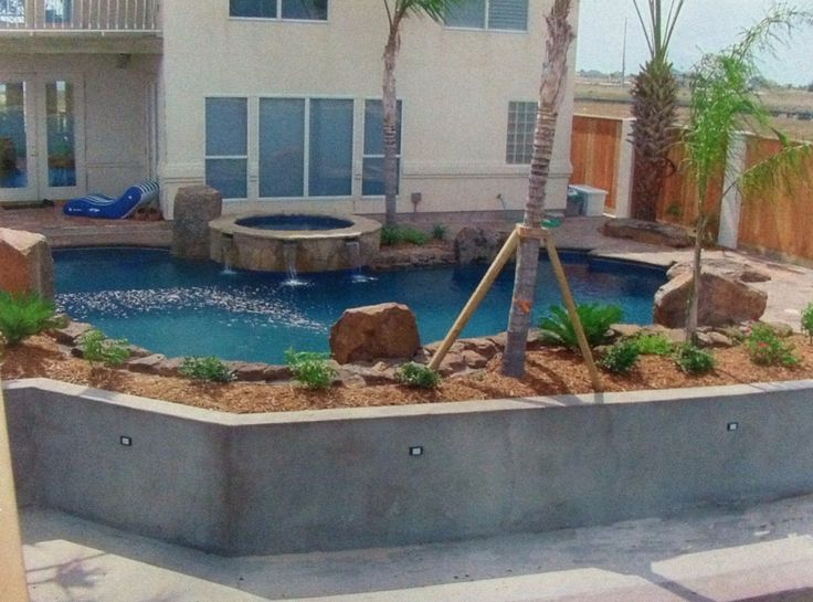 27 best retaining walls images on pinterest backyard for Pool design retaining wall