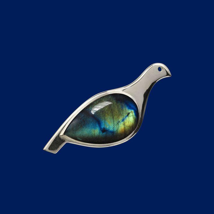 Ptarmigan, brooch, silver, spectolite. Riekko, rintakoru, hopeaa, spektroliitti. Design Juha Janger