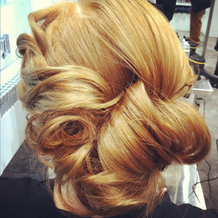 Curled, twisted, and pinned updo hairstyle. #hair #updo #kenra #RedCarpet