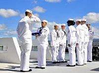 Members of the Joint Base Pearl Harbor-Hickam Honors and Ceremonial Guard participate in an ash scattering ceremony.