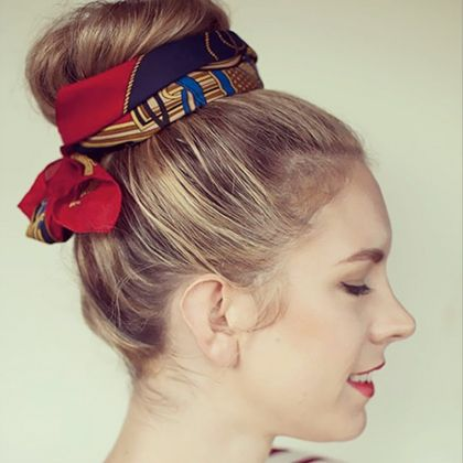 Accessorizing doesn't have to end with your outfit! Tie your favorite silk scarf around a top knot for a fun look that helps hide second-day dirty...