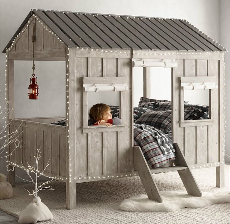 Cabin Bed for Kids. It's for sale by Restoration Hardware but I think it would be easy enough to build. Super cute!