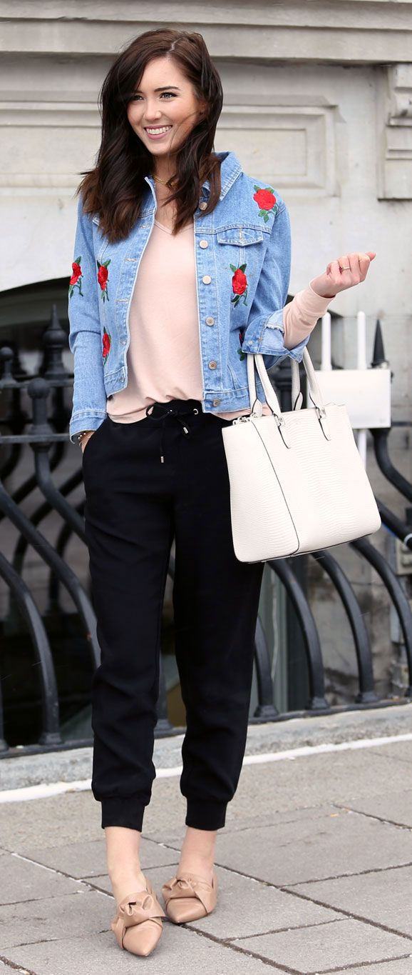 style embroidery in the spring: embroidered flower denim jacket. perfect casual style with black joggers and blush flats