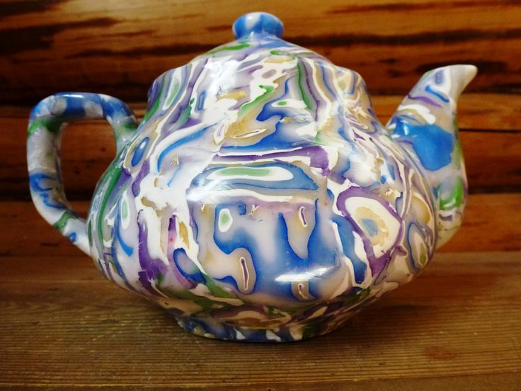 Tea pot made of translucent polymer clay on porcelain