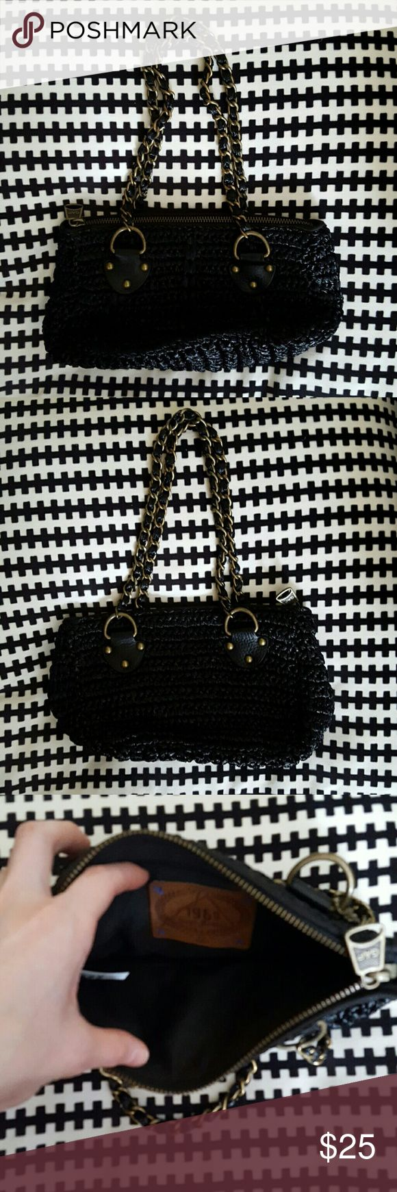 NWOT Gap Black Woven Purse Gap 1969 Jeans black woven purse with bronze hardware. 10 x 5 inches. Small zippered pocket inside. GAP Bags Mini Bags