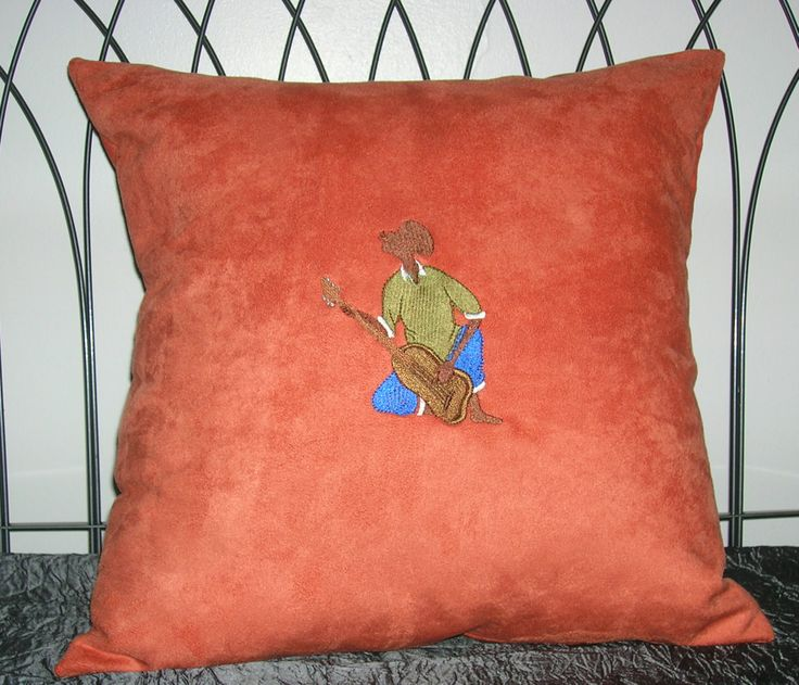 Embroidered faux suede throw cushion.