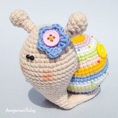 This little lady snail would look perfect in your floral corner within cute flowerpots  Try this quick and rewarding crochet project, find the snail pattern on Amigurumi Today!  #crochet #crocheting #crochetproject #amigurumi #amigurumis #amigurumipattern #crochetpattern #crochettoy #crochettoys #amigurumitoy #amigurumicrochet #amigurumis #handmade #crafting #instacrochet #instacrocheting #snail #snails #cute #patterns