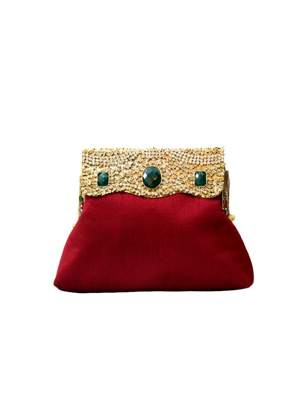 This stylish red raw silk clutch by Meera Mahadevia features an elegant and striking design. It has been accentuated by a gold top opening on the front encrusted with semi precious stones and fringes. It displays a traditional yet contemporary aesthetic with a royal covetable look which sure to grab attention.