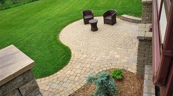 Nice view of walkout basement circular paver patio.
