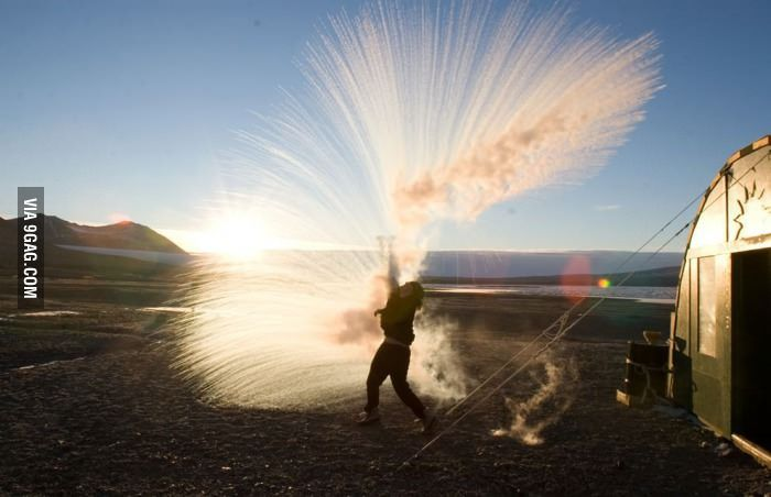 Researcher throws hot water into the air watching it turn to ice crystals in Antarctica