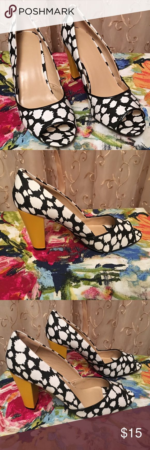 """Avon Blurry Dot Fashion Pumps Blurry Dot Fashion Pumps. Mod peep toe pump in graphic black and white with bright yellow heel for a pop of color. Features: Peep Toe; Upper is black with white dots that have blurred lines; Heel is Chunky, solid yellow with black trim at bottom. Size 8. Bottom of soles are skid resistant; heel height 3 1/2"""" H. Materials: Fabric, PU (polyurethane), TPR (Thermal Plastic Rubber) New in original packaging. Item shown is the item you will receive. Stunning heels…"""