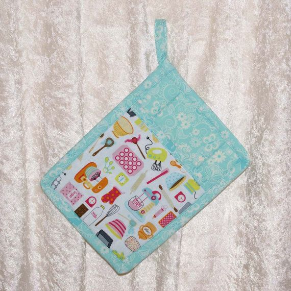 Handmade pot holder featuring designer fabric in retro kitchen icons on white and a coordinating turquoise pattern adds fun to your kitchen.
