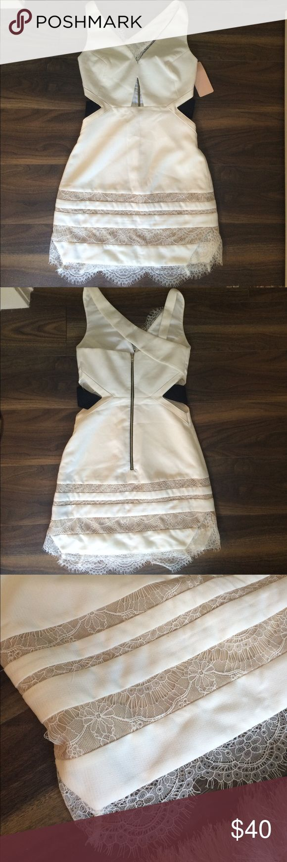 Three Floor NWT White Isle lace dress XXS/US 2 Never worn Three Floor dress! XXs/ US 2. White with lace bottom and edges, cut out middle, and asymmetrical back with gold zipper. 🔥🔥🔥 Three Floor Dresses