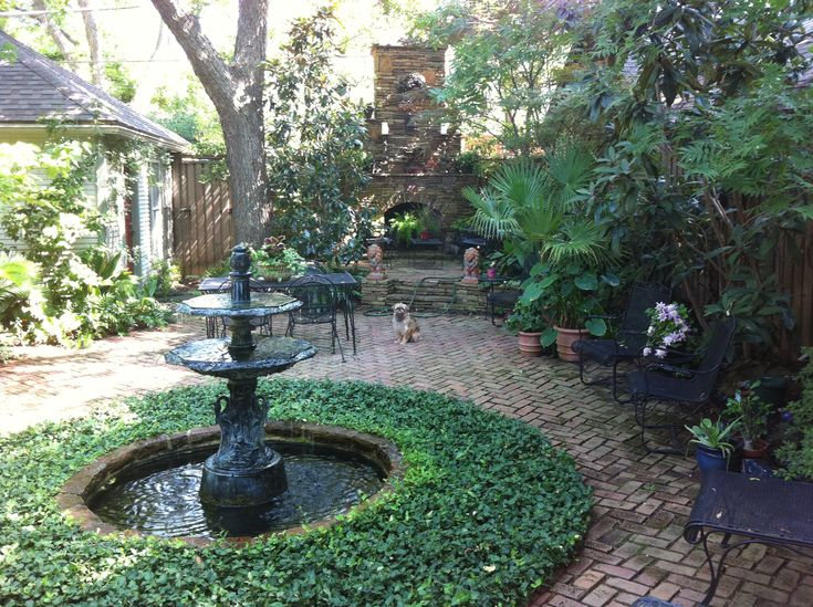 New orleans courtyard backyard kernels pinterest gardens fireplaces and furniture - Classic courtyards and gardens elegant landscapes ...