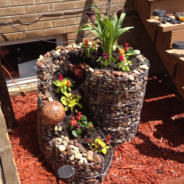 garden design with rock flower pot picture source