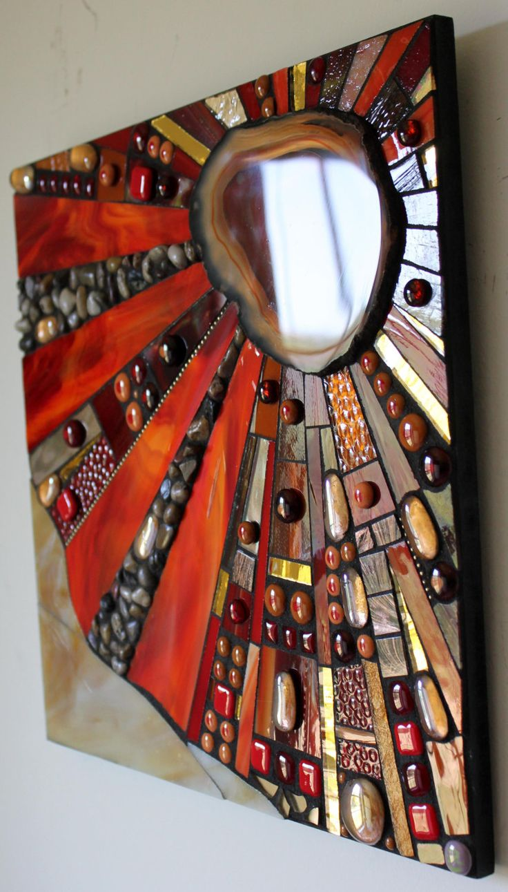 This beautiful mosaic features a large, red and rust colored polished agate slice in the upper right corner. Thus the piece is named Agate