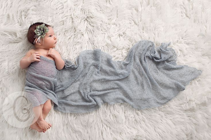 Usually I don't appreciate the posed newborn pictures but I like this one. Natural pose, with just a little bit added.