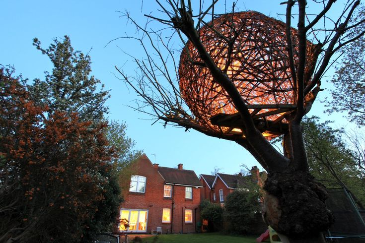 An Illuminated Woven Willow Tree House by Tom Hare