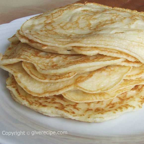 Very thin crepes. Stuff these with cheese or jam or even with nutella and have a festive breakfast! | giverecipe.com | #crepes #breakfast