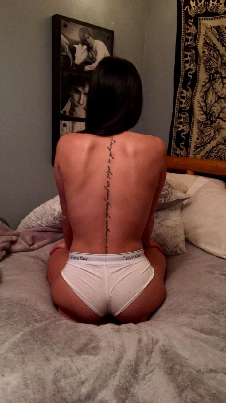 "Spine Tattoo. ""Strength is what we gain from the madness we survive"""