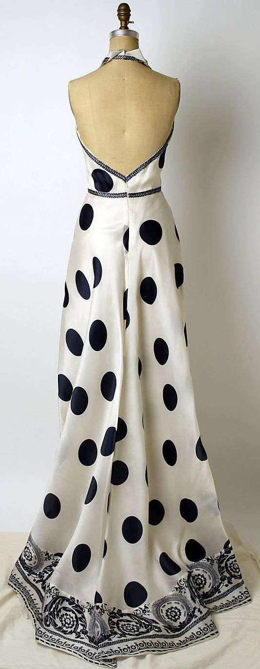 Dress, Evening  Carolina Herrera  (American, born Venezuela, 1939)  Date: late 20th century Culture: American Medium: synthetic.  Credit Line: Gift of Carolina Herrera, 2005.  I LOVE LOVE LOVE the dots and the super-cute border of the dress!!!