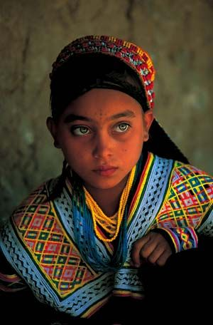 Kalasha girl.  The Kalasha live in the North-West Frontier Province of Pakistan in the higher valleys of the southern Hindukush. They are a pagan people still practising their ancient customs and the women and girls still wear traditional dress.