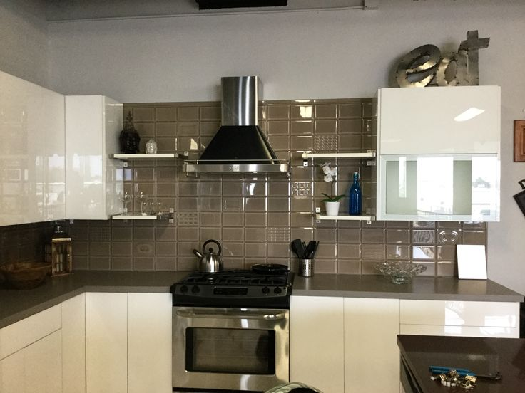 European style, Acrylic white frameless cabinets, now at Siena Decor/Andersen Cabinets. Introducing Cento Per Cento 5x7 backsplash..... Directly from Imola, Italy