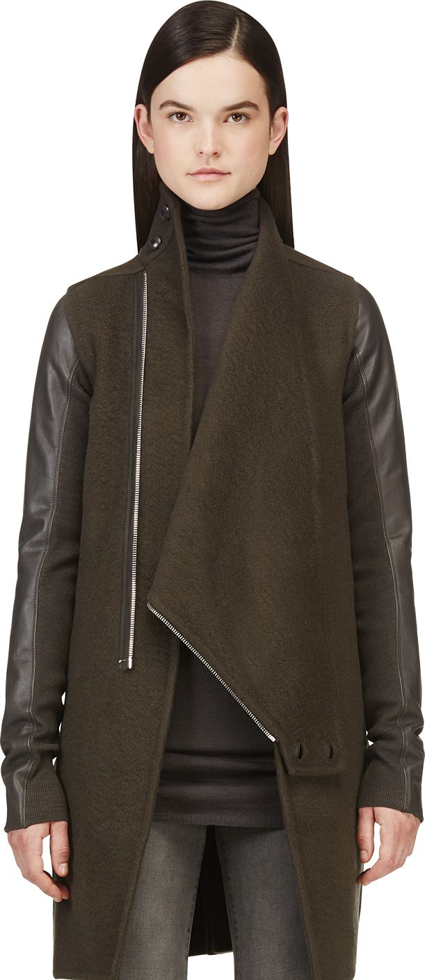 Long sleeve cashmere coat in brown. Double buttoned drape collar. Oblique zipper. Tonal leather sleeves with ribbed trim panels. Seam pockets at front. Vented at back hem. Partially lined. Tonal stitching.  RICK