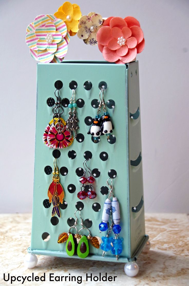This homemade earring holder is perfect for dangling earrings that need to be better cared for. An easy upcycled craft idea for an old cheese grater!