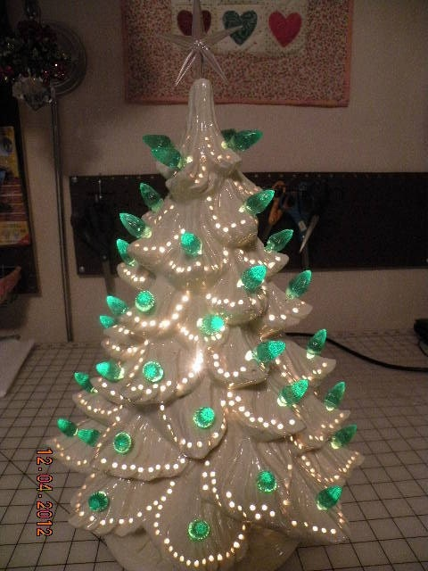 White Ceramic Christmas Tree-would need to poke holes when wet, but interesting idea.....