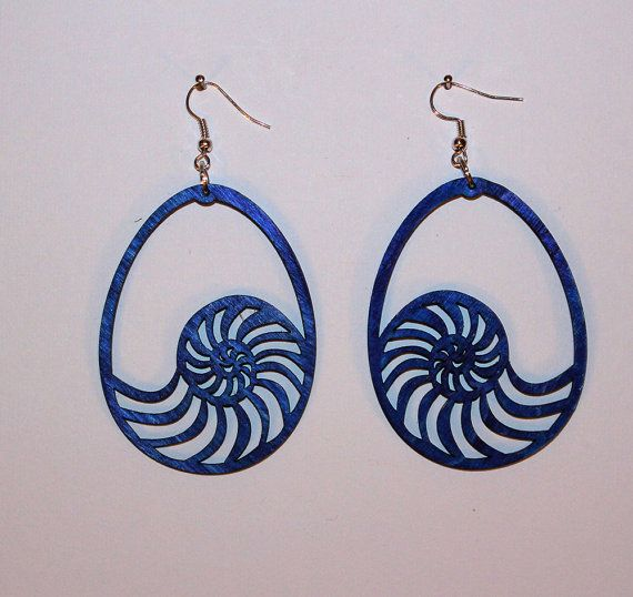 Check out this item in my Etsy shop https://www.etsy.com/listing/492242166/handmade-wooden-earrings-shell