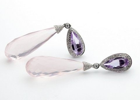 These striking chandelier earrings are crafted of solid white gold and feature genuine rose quartz accented by genuine natural diamonds. These earrings hang approx 2 inches and are ready for any Red Carpet.