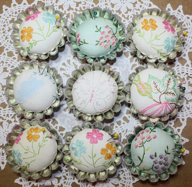 small up-cycled tart tins -- pin cushions with vintage embroidered linens