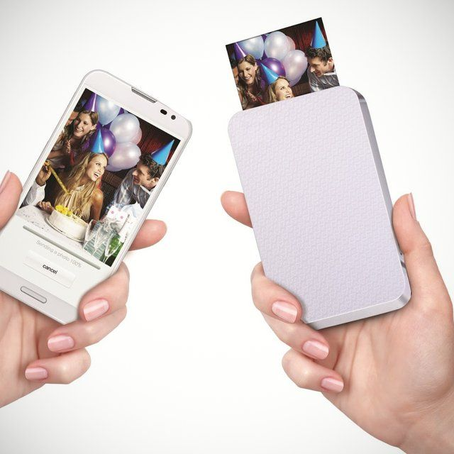 """This palm-sized wireless printer produces pictures from a smartphone. The printer stores unobtrusively in a pocket and uses Bluetooth to access pictures on an iPhone (NFC for Android devices) to print 2"""" x 3"""" color photos in less than a minute."""